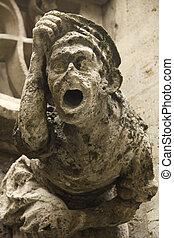 Grotesque gargoyle - Carved stone grotesque figure in...