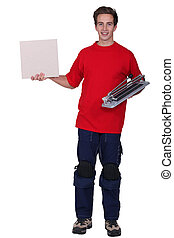portrait of young delivery man holding board