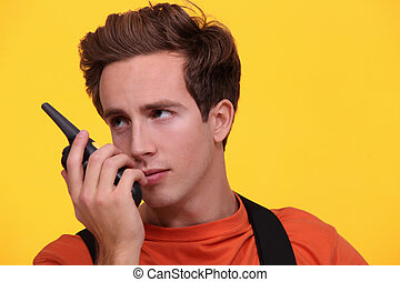 male worker using a talkie walkie