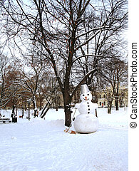 Big snowman in park in winter