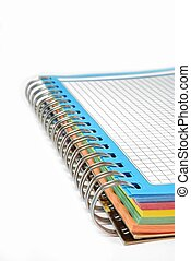 Spiral sketchbook, opened on a blank page, isolated