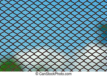 Rusty fence on blue sky - Chain link rusty fence on a blue...