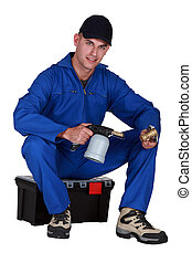 Worker with a blowtorch