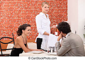 Couple ordering a wine in a restaurant