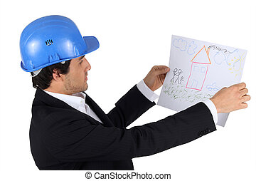 An engineer looking at a child's drawing