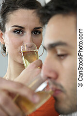 Couple drinking champagne to celebrate house purchase