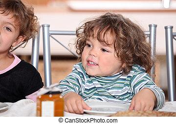 portrait of siblings having snack after school