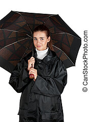 woman in rain coat with umbrella on a white