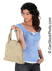 Young woman carrying handbag