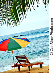 umbrella and lounge chair on the exotic island - umbrella...