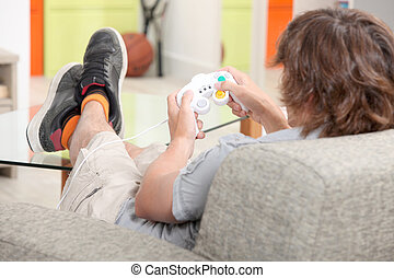 A teenager playing a video game