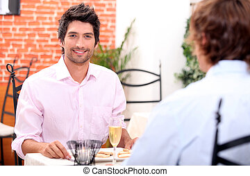 Male couple at restaurant