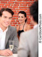 Woman in background of restaurant