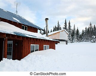 House buried in snow - Snow piled up around house covering...