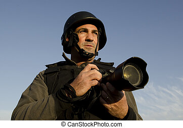 Professional Photojournalist - A male press photographer...