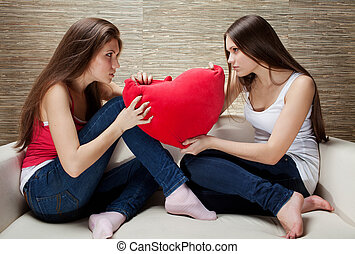 girls fight on pillows - Girls on the cushions in the form...