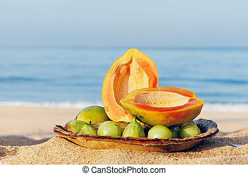 Two half papaya - Exotic tropical fruit on the leaves plate...
