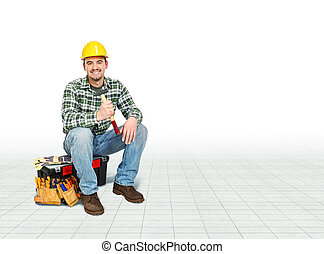 handyman - smiling caucasian handyman sit on toolbox