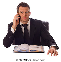 a young business man on the phone.