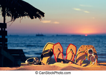 Beach Accessories - Beach sandals and glasses on the beach...