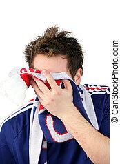 Downcast French football fan