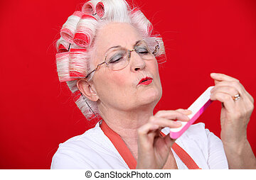 Old woman in rollers