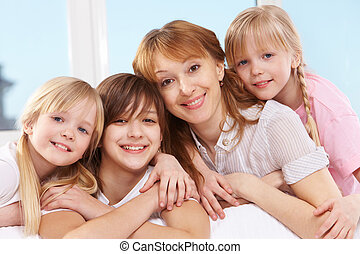 Row of females - Portrait of happy mother and her three...