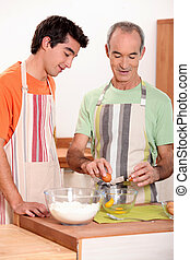 senior and junior cooking together
