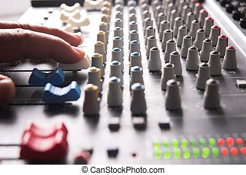Mixing Desk - Sound recording mixer with hand controlling.
