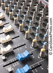 Mixing Desk - Sound recording mixer with faders and knobs.