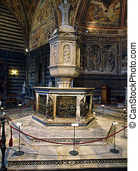 Siena - baptismal font situated in the central place of the...