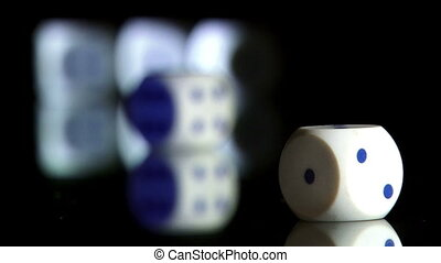 Rolling dice, shallow depth of field
