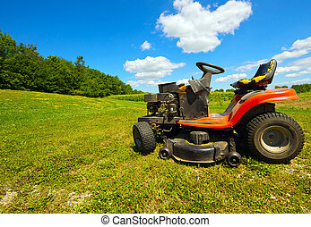 Wide angle old mower - Wide angle image of an old mower at...
