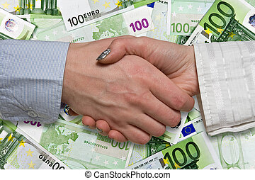 Eurozone deal concept business handshake on euros background...