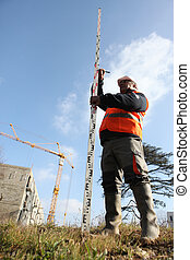 Geometer on construction site