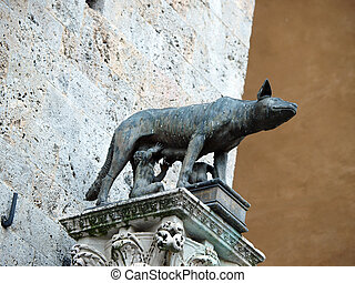 Siena - the town's emblem; a she-wolf suckling the infants...