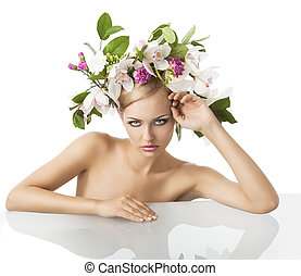 pretty blond with flower crown on head, she is in front of the c