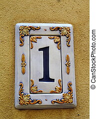 House number one 1 - House number one sign on the wall