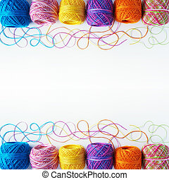 Yarn coils on white - Colorful knitting yarn coils over...