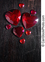 Heart Stones - Several heart shaped red rubi gem stones over...