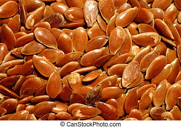 A closeup picture of brown flaxseeds (linseeds) - Closeup of...