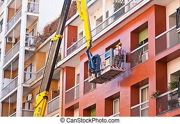 Crane working in a red building