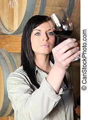 Young woman tasting wine