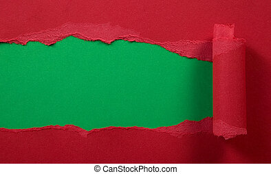 Ripped red paper with green background