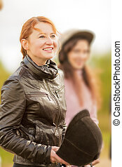 happy jockey - smiling equestrian red haired girl with...