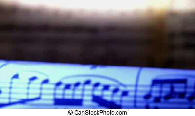 Sheet music, notes, blue light