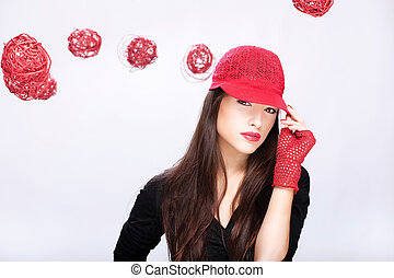 woman with red hat between red balls - Pretty woman with red...