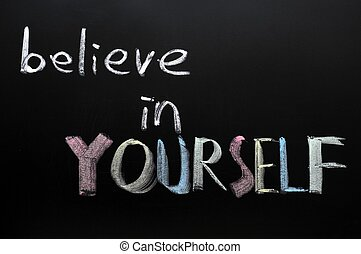 Believe in yourself written in chalk on a blackboard