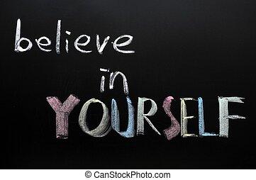 Believe in yourself written in chalk on a blackboard