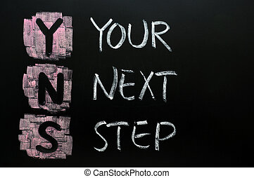 Your next step written in chalk on blackboard